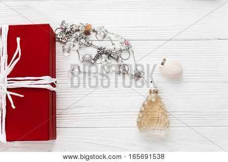 Stylish Red Present And Luxury Expensive Jewelry And Perfume Flat Lay On White Rustic Wooden Backgro