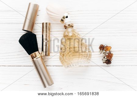 Luxury Jewelry Perfume Make Up Essentials Flat Lay On White Rustic Wooden Table In Soft Morning Ligh