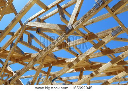 New framing construction of residential house over blue sky