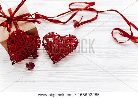 Valentine Day Concept. Stylish Craft Present Box And Red Heart On White Rustic Wooden Background. Gr