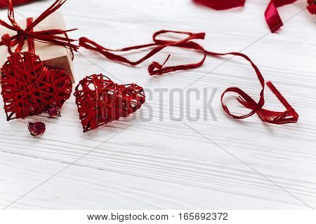Stylish Hearts And Craft Present Box On White Wooden Background. Happy Valentines Day Concept. Greet