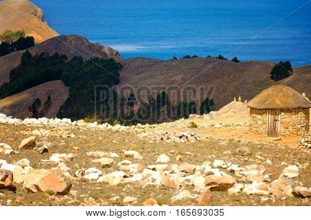 Small hut on the Island of the Sun in Bolivia with Lake Titicaca in the background