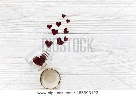 Stylish Velvet Hearts In Glass Jar On White Wooden Background Flat Lay. Happy Valentines Day. Greeti
