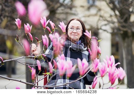 Beautiful Middle Aged Admiring Pink Magnolia