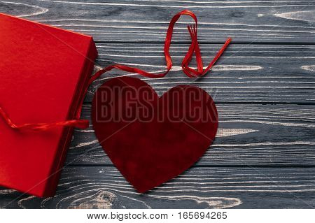 Stylish Red Present And Velvet Heart Ribbons Flat Lay On Black Rustic Wooden Background. Happy Valen