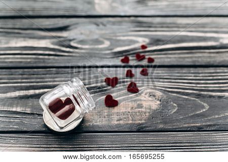Stylish Velvet Hearts In Glass Jar On Black Rustic Wooden Background. Happy Valentine Day. Unusual G