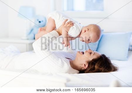 Baby And Mother At Home. Mom And Child.