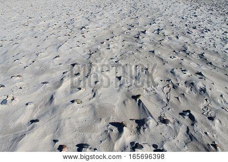 Textured Background with Small Stones, Sand and Windy Prints. Sand Background. Beach Background.
