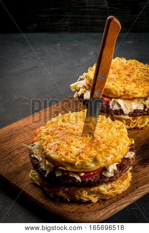 Modern Asian cuisine Ramen burger: a sandwich with bread noodle was used instead of buns. Copy space