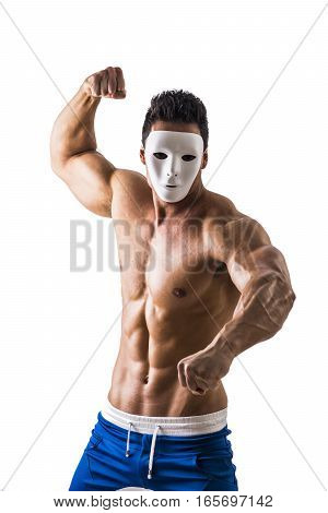 Shirtless muscle man with creepy, scary mask being aggressive and violent, isolated on white background