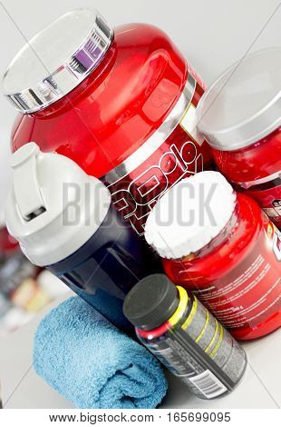 Bottles with protein powder and other necessary bodybuilding supplements.