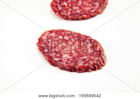 salami isolated on a white background. Stock image