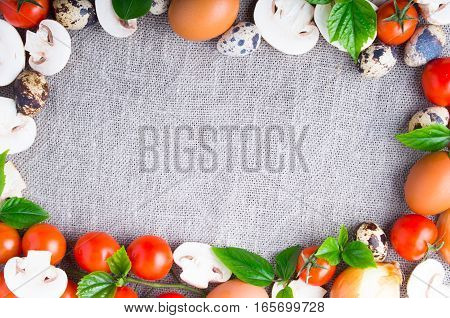 Top View Of A Mushroom, Onion, Eggs, Cherry Tomatoes And Quail Eggs