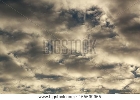 cirrus clouds with dramatic shadows on overcast day