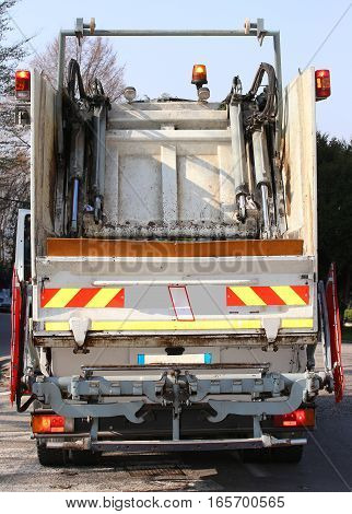 Garbage Trucks During The Solid Waste Collection Service In The