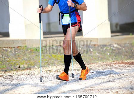 Athlete Runner During The Nordic Walking Training With The Nordi