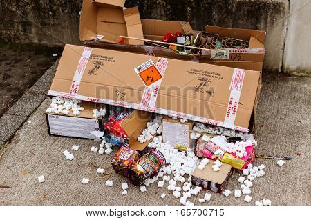 Strasbourg France - Jan 1 2017: Petard and fireworks cardboard boxes thrown away after new year party birthday wedding celebrations