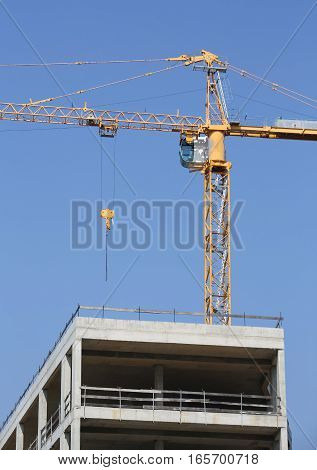 Building Under Construction  And A Yellow Crane