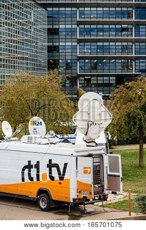 STRASBOURG FRANCE - OCT 7 2015: Tv Televison Truck with multiple Satellite parabolic antennas and fiber optic cables going inside reporting live the official French president visit to the European PArliament in Strasbourg France