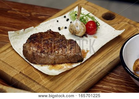 Juicy Grilled Steak With Fried Potatos Pepper Tomato And Garlic. Serving Beefsteak On Wooden Desk. C
