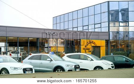 STRASBOURG FRANCE - DEC 21 2016: Opel showroom in city with cars presented outside car dealer. Adam Opel AG is a German automobile manufacturer headquartered in Rüsselsheim Hesse Germany subsidiary of the American group General Motors.