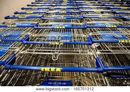 PARIS FRANCE - APR 12 2016: Empty supermarket carts in IKEA furniture supermarket store. Point of view of a customre over the supermarket aisle and ikea logo