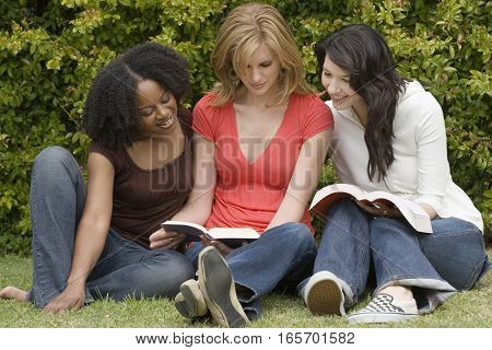 Happy diverse group of women studying together.