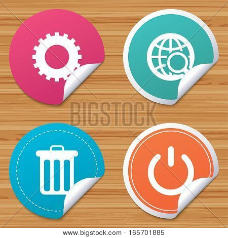 Round stickers or website banners. Globe magnifier glass and cogwheel gear icons. Recycle bin delete and power sign symbols. Circle badges with bended corner. Vector