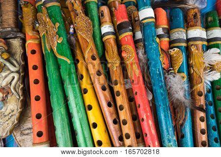 colourful wooden indigenous flutes closeup in Ecuador