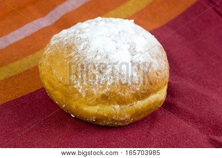 Fresh european donut on a table berliner