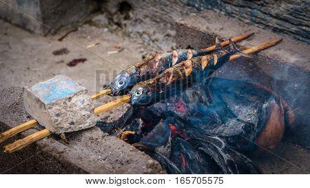 Local Street food - grilled fish, Sardine, Bali - Indonesia