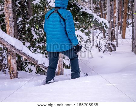 Female snowshoeing in fresh powder snow alone