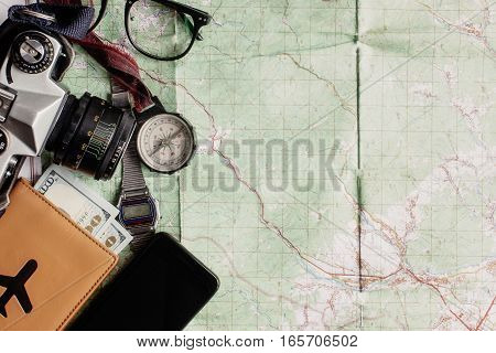 Wanderlust And Adventure Concept, Old Compass Phone Photo Camera Glasses Passport And Money Lying On