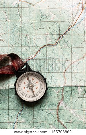Wanderlust And Explore Concept, Old Compass Lying On Map, Top View, Space For Text, Vintage Toned Im