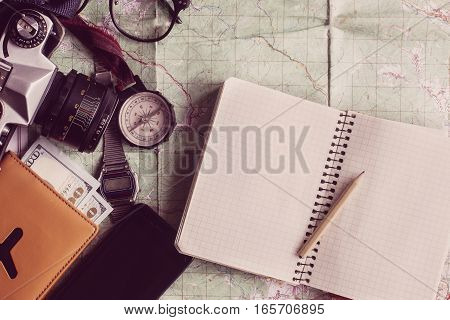 Wanderlust And Adventure Concept, Compass Camera Glasses Passport Money Notebook Lying On Map, Top V
