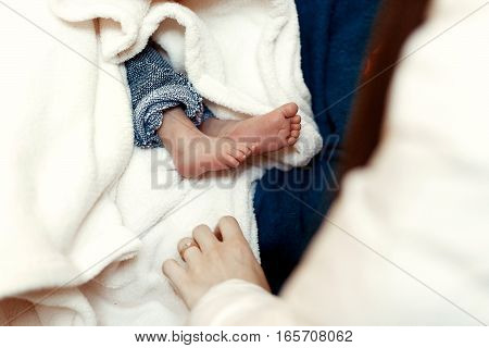 Baby Baptism. Cute Feet Of A Little Boy At Christening Ceremony In Church