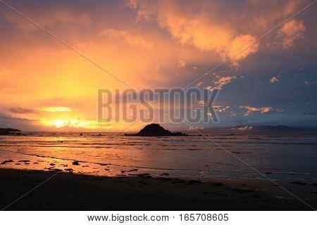 Sunset at Monkey Island Beach in New Zealand