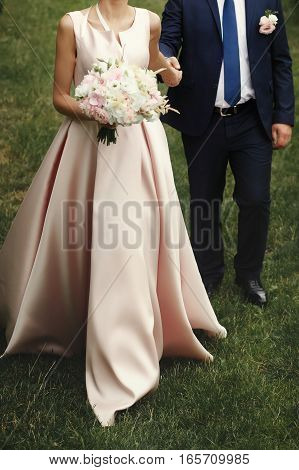 Bride And Groom Hugging Walking, Holding Hands, Luxury Wedding Couple With Amazing Bouquet, Tender R
