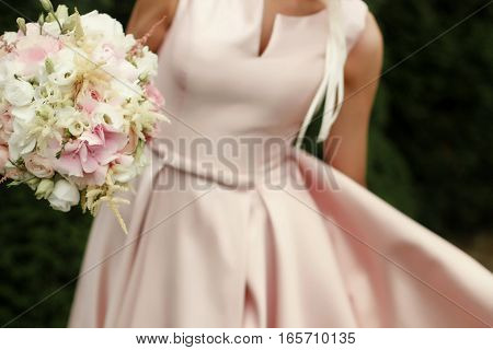 Bride Holding Wedding Bouquet Of Pink And White Flowers In Hands Dancing In Tender Rich Dress, Sensu
