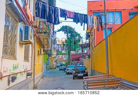 The old shady backstreet with drying clothes is the typical for Batumi Georgia.