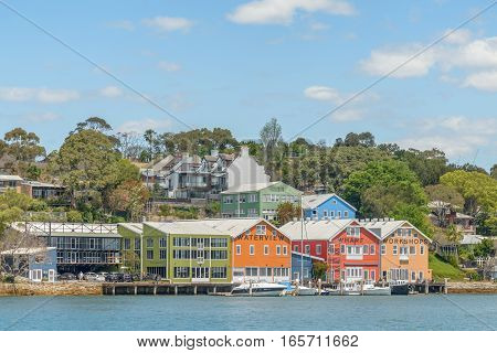 SYDNEY AUSTRALIA - OCTOBER 11 2016: East Balmain waterfront offices and homes in Sydney Harbour New South Wales Australia.