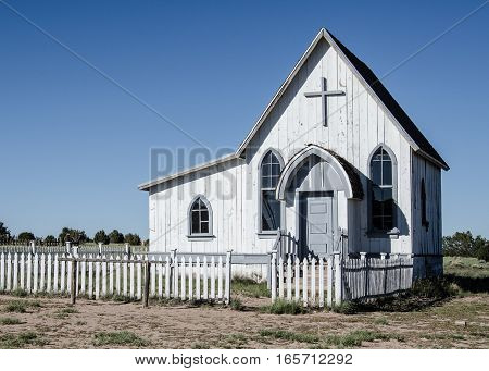 WHITE WOODEN CHURCH ON THE PRAIRIE WITH CROSS