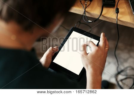 Stylish Man Holding Tablet With Empty White Screen And Touching, Sitting At Meeting, Business Market
