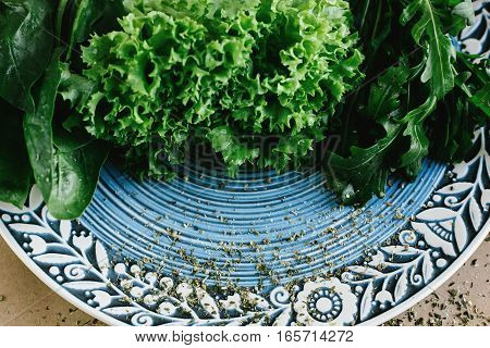 Delicious Fresh Salad Arugula Spinach On Amazing Plate On Craft Background, Top View