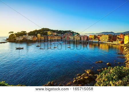 Sestri Levante silence bay or Baia del Silenzio sea harbor and beach view on sunset. Liguria Italy Europe.
