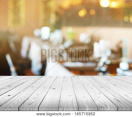 wood table top on blurred of restaurant bokeh background