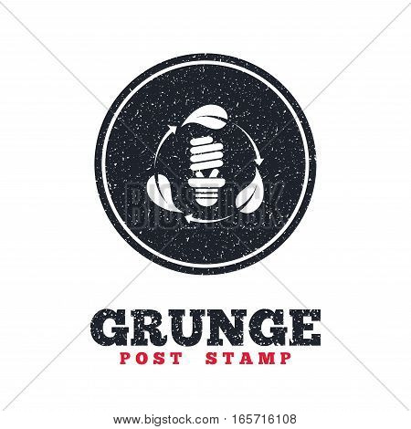 Grunge post stamp. Circle banner or label. Fluorescent lamp bulb with leaves sign icon. Energy saving. Economy symbol. Dirty textured web button. Vector