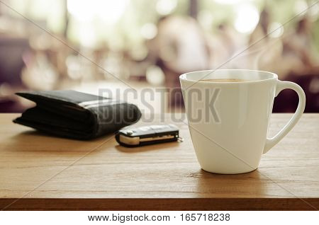 Cup Of Coffee, Wallet And Car Remote Key On Wooden Table In Coffee Shop.