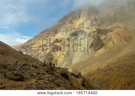 Climbing to the active volcano Mutnovsky on Kamchatka.