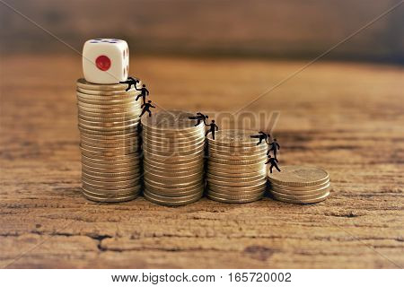 stack of coins with dice money and business team work concept.